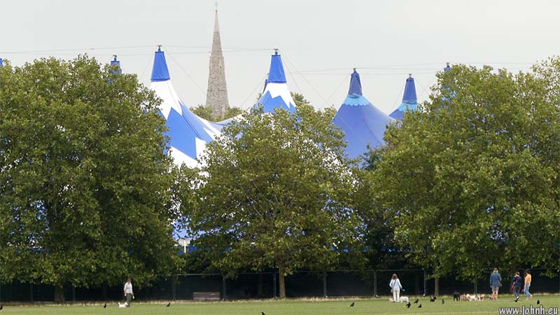 The spire of St Mary's Clapham amongst the tops of the circus tents