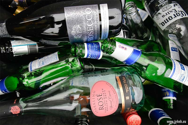 Christmas party bottles in the recycling bin